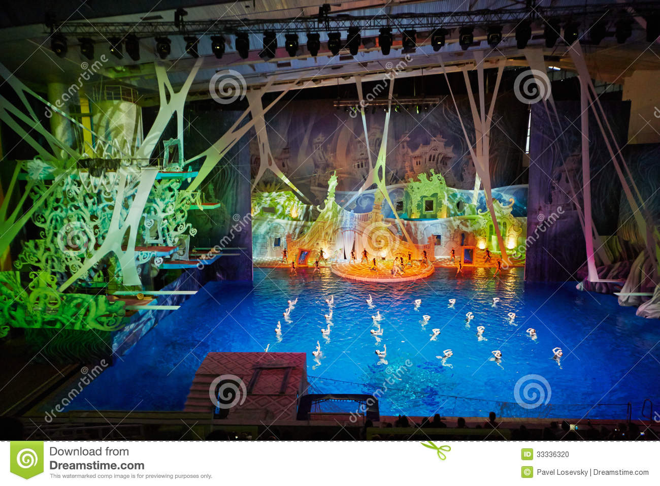 Swimming Pool Stage : Actors on stage and synchronized swimmers editorial image