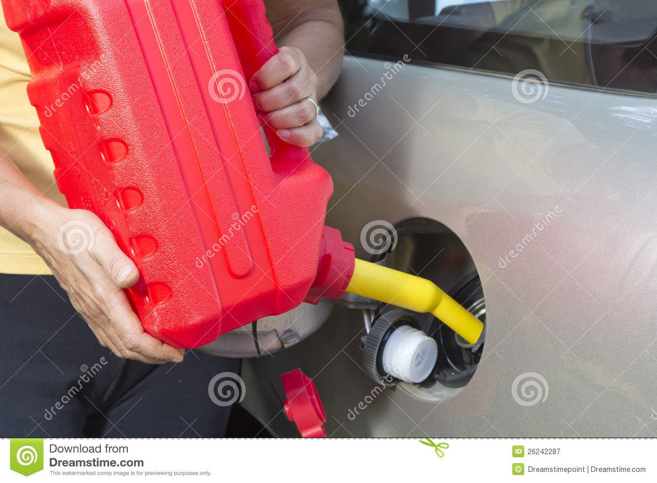 Adding fuel in car with Red Plastic Gas can
