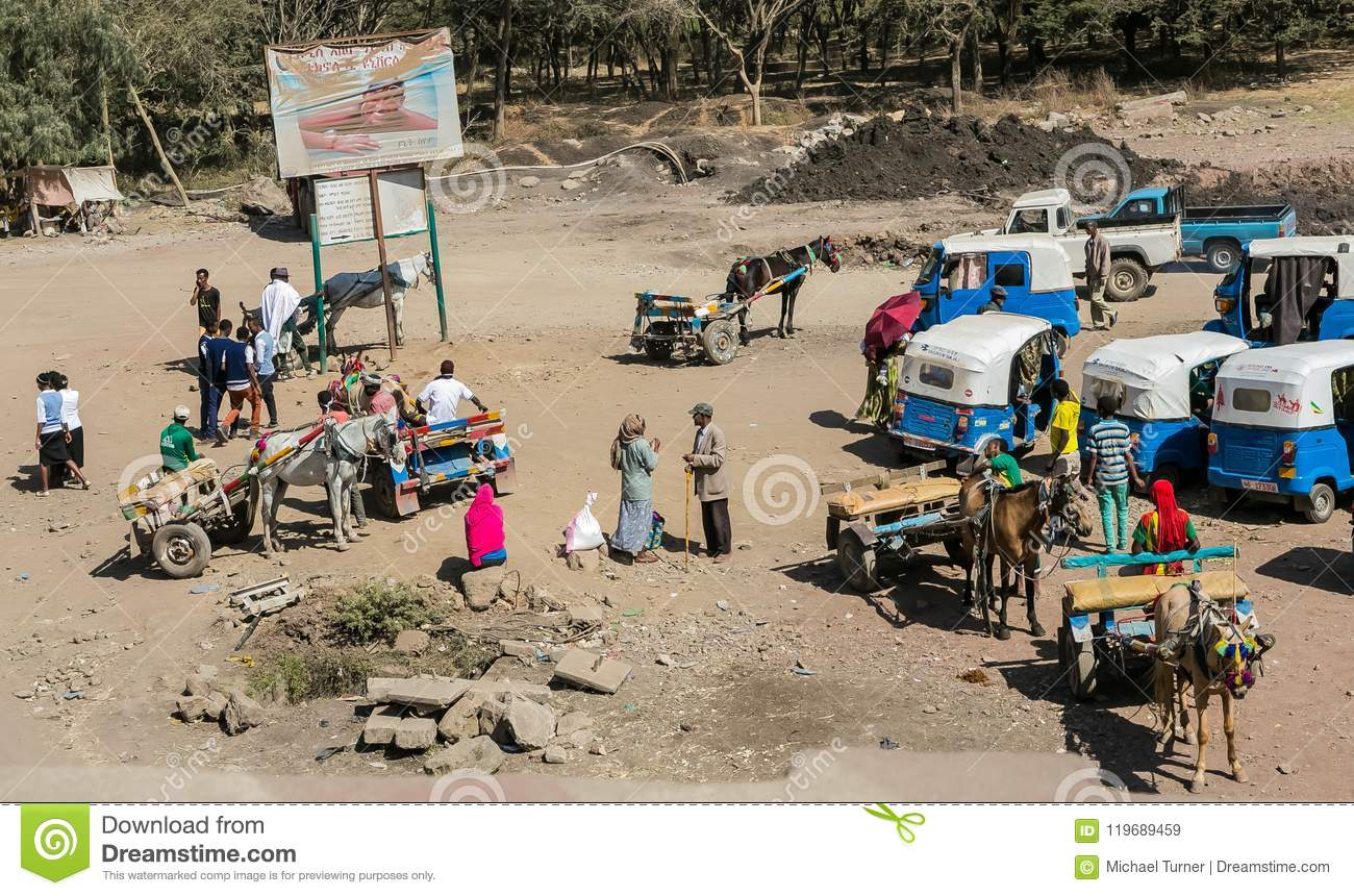 Donkey-carts and taxis on the side of the road