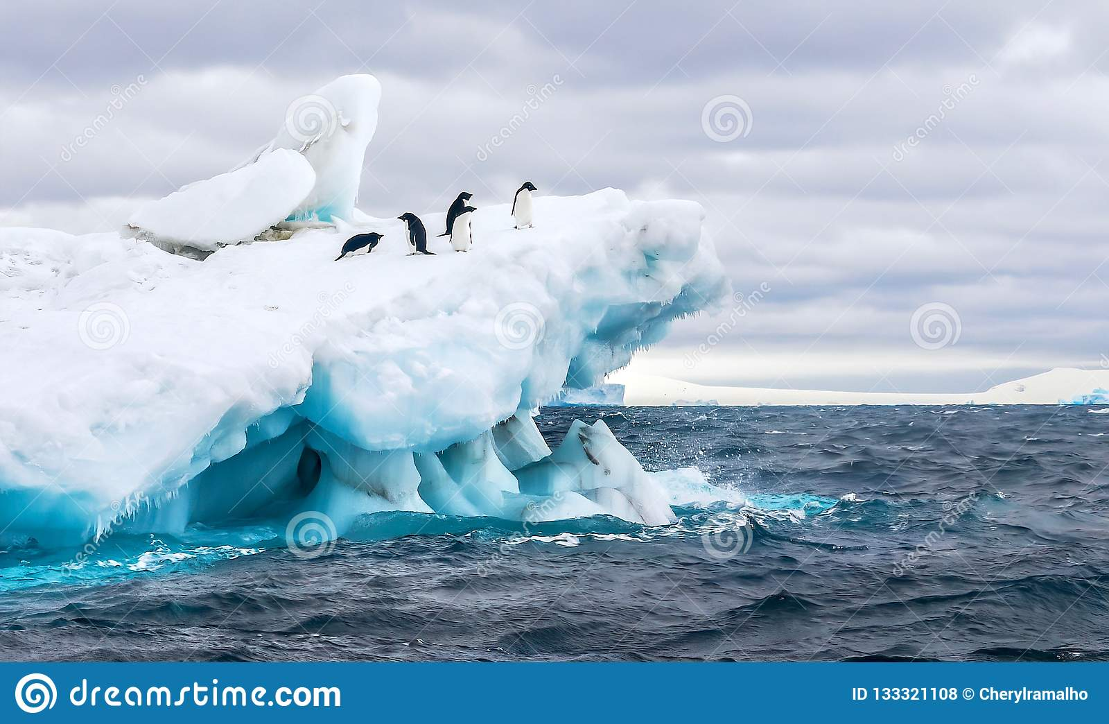 Adelie penguins on a beautiful iceberg in Antarctica.