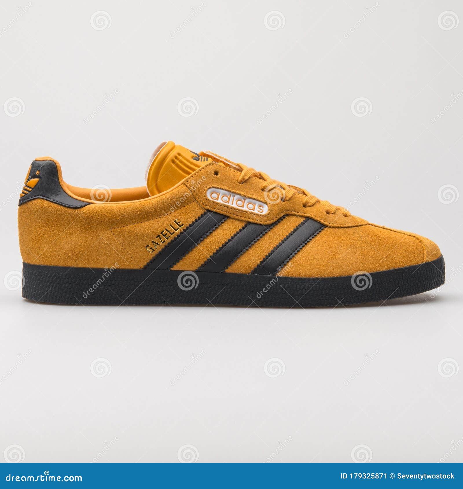 Adidas Gazelle Orange And Black Sneaker Editorial Photo - Image of ...