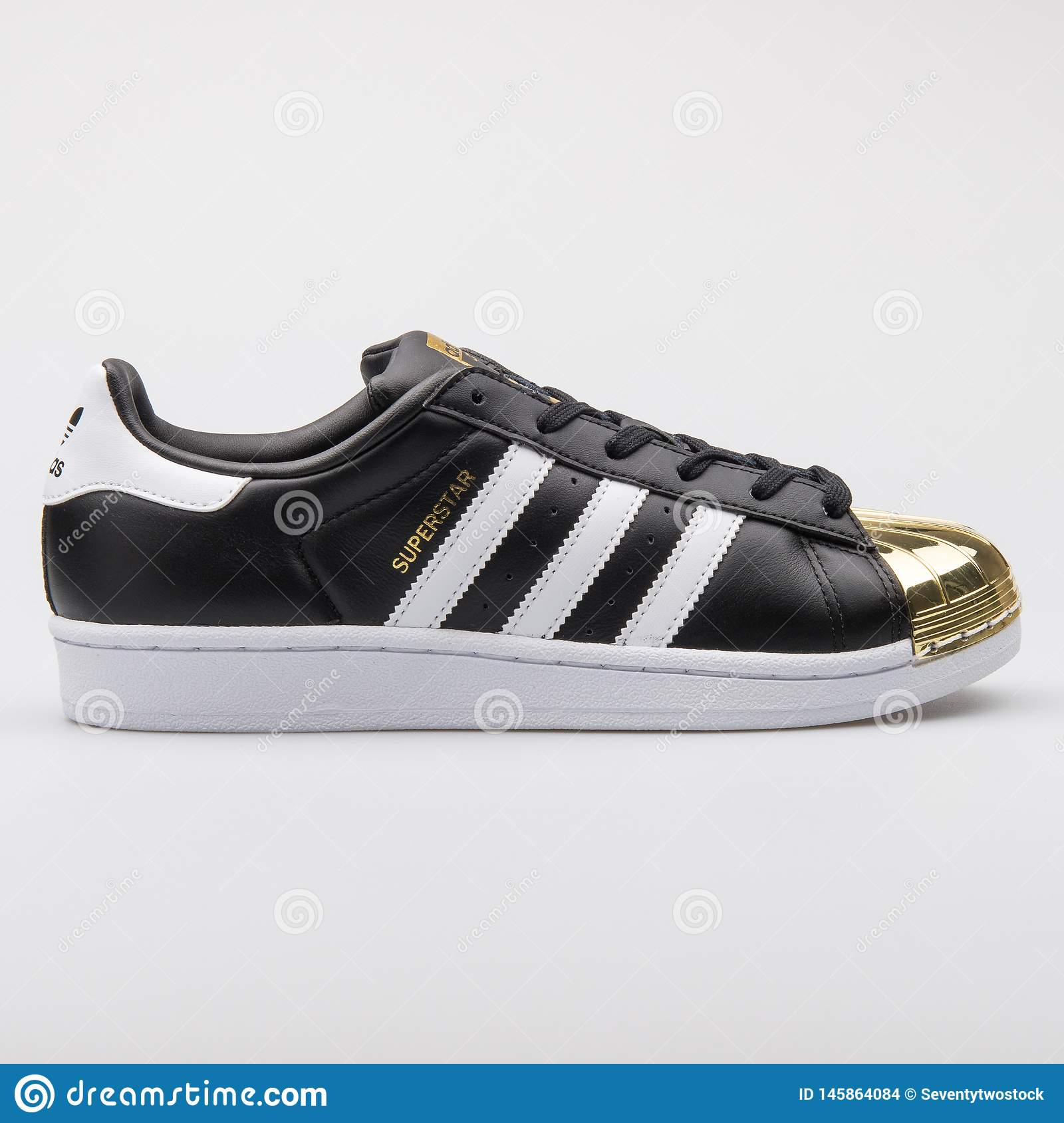 98c91189 Adidas Superstar Metal Toe Black And Gold Sneaker Editorial Stock ...