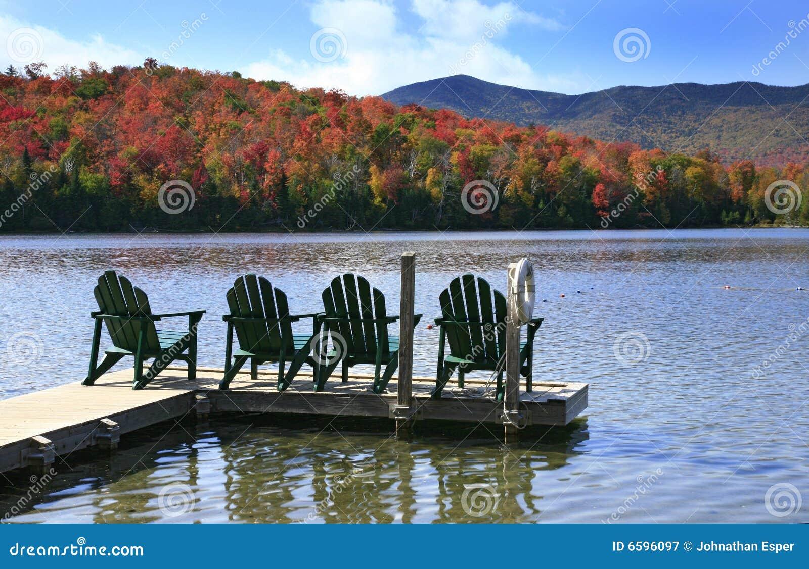 Adirondack chairs on lake stock image. Image of foliage ...