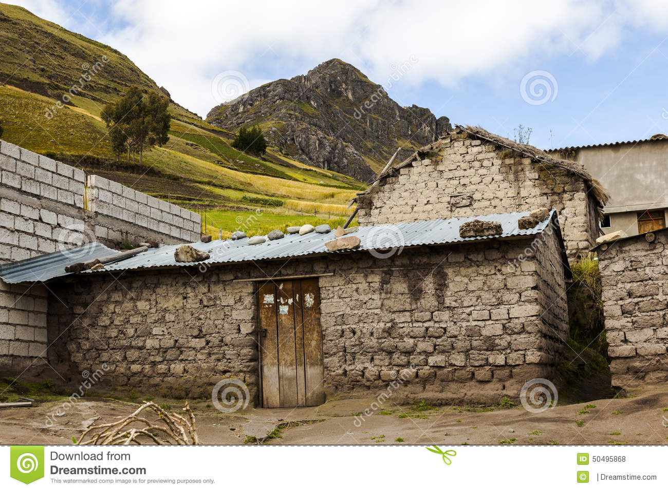 Adobe house with a zinc roof around zumbahua stock photo for Adobe roof