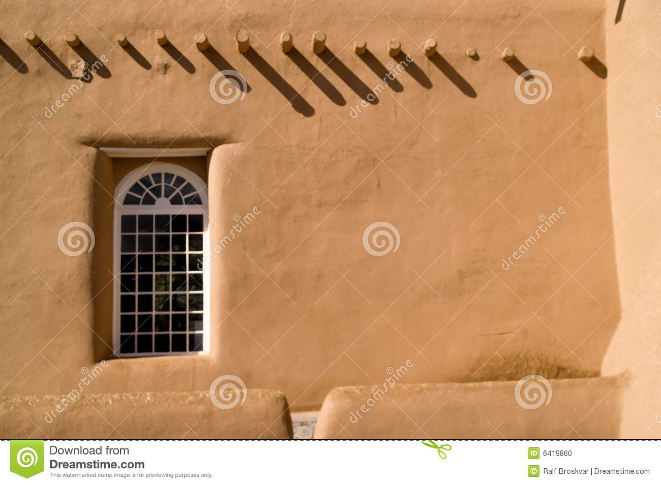 Adobe wall with window and shadows