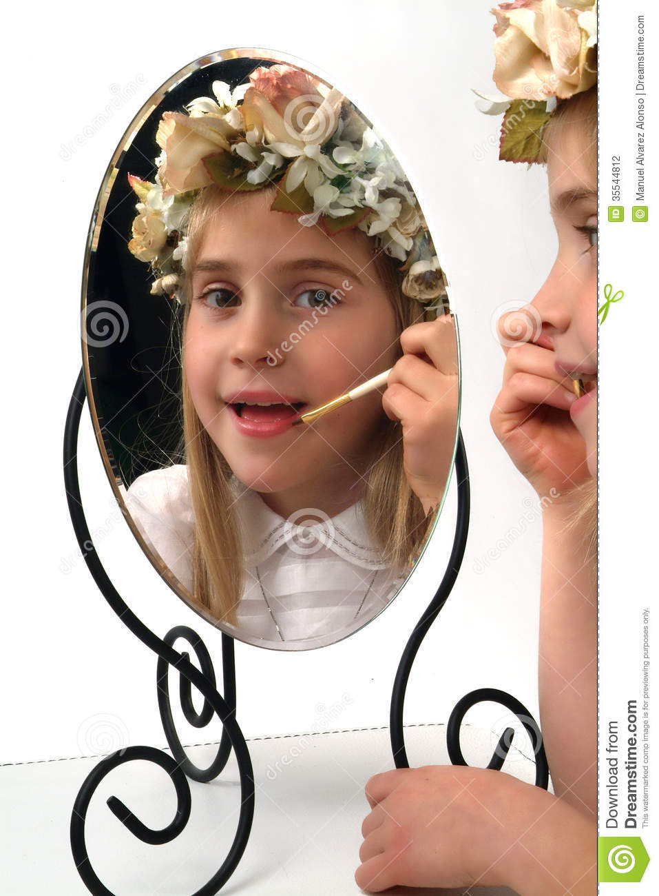 Adolable little girl looking in a mirror stock photography for Mirror 7th girl