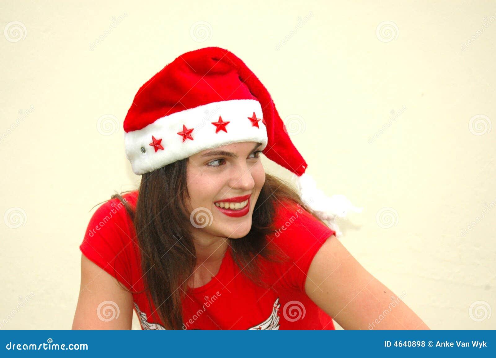 Adolescente com chapéu de Santa