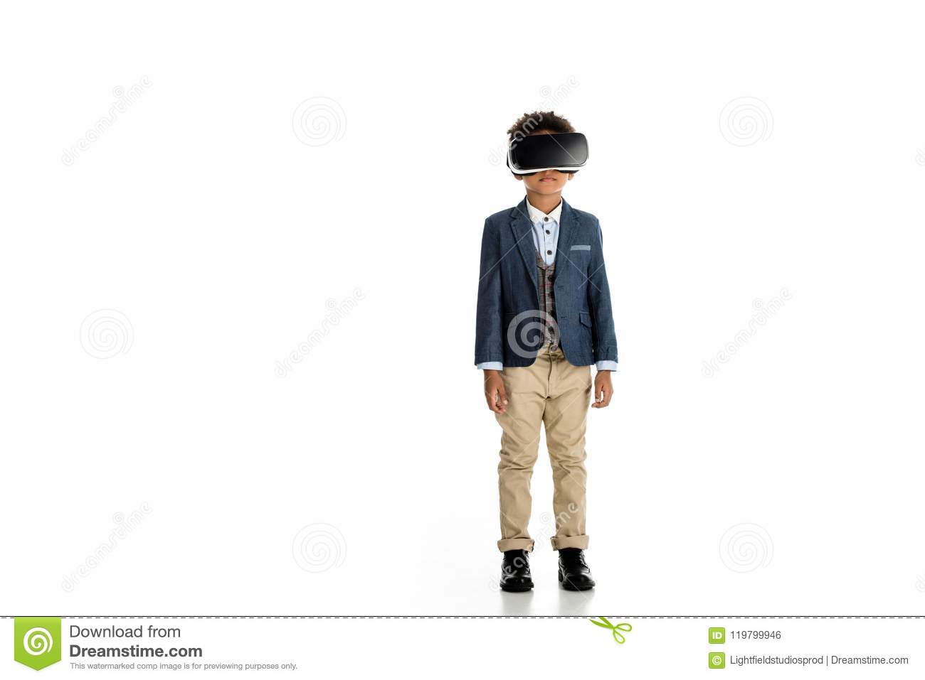 adorable african american child standing with virtual reality headset