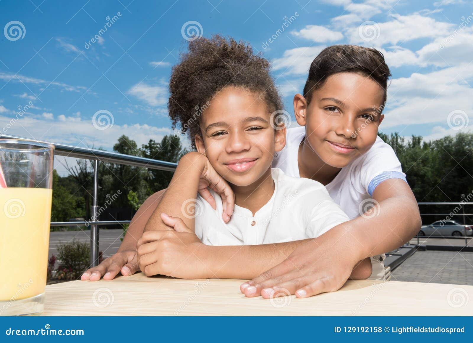 adorable african-american kids embracing
