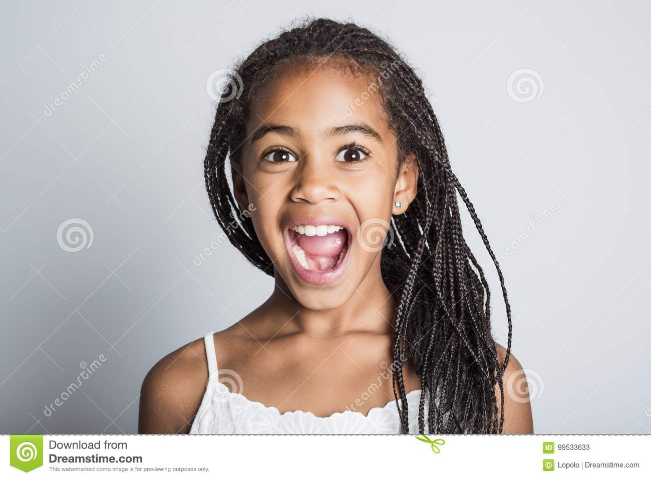 Adorable african little girl on studio gray background