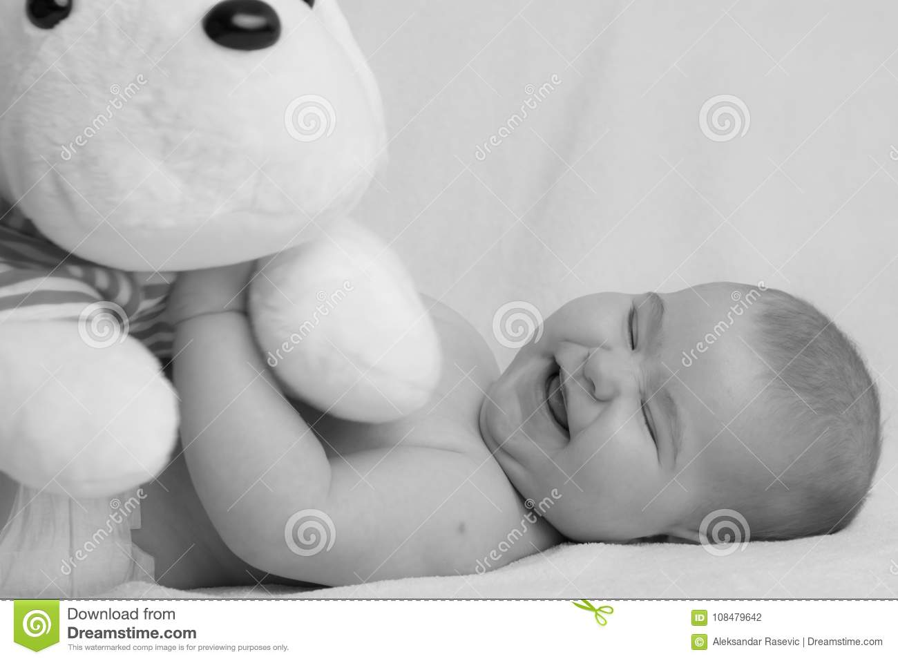 Adorable Baby Girl Playing With A Plush Toy In Black And White Stock Photo Image Of Monochrome Happiness 108479642