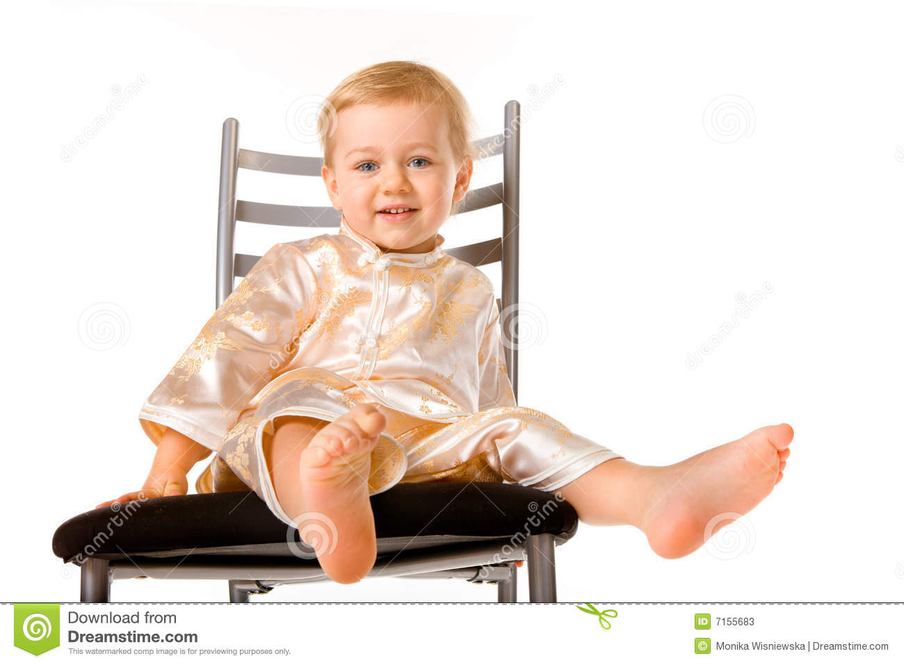 Adorable baby girl sitting on a chair stock photos image for Toddler sitting chair