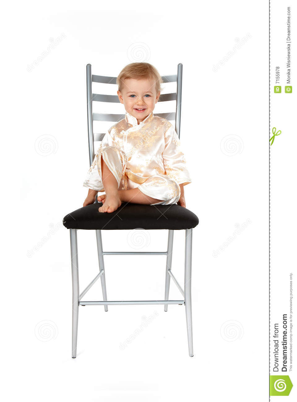 Adorable baby girl sitting on a chair royalty free stock for Toddler sitting chair