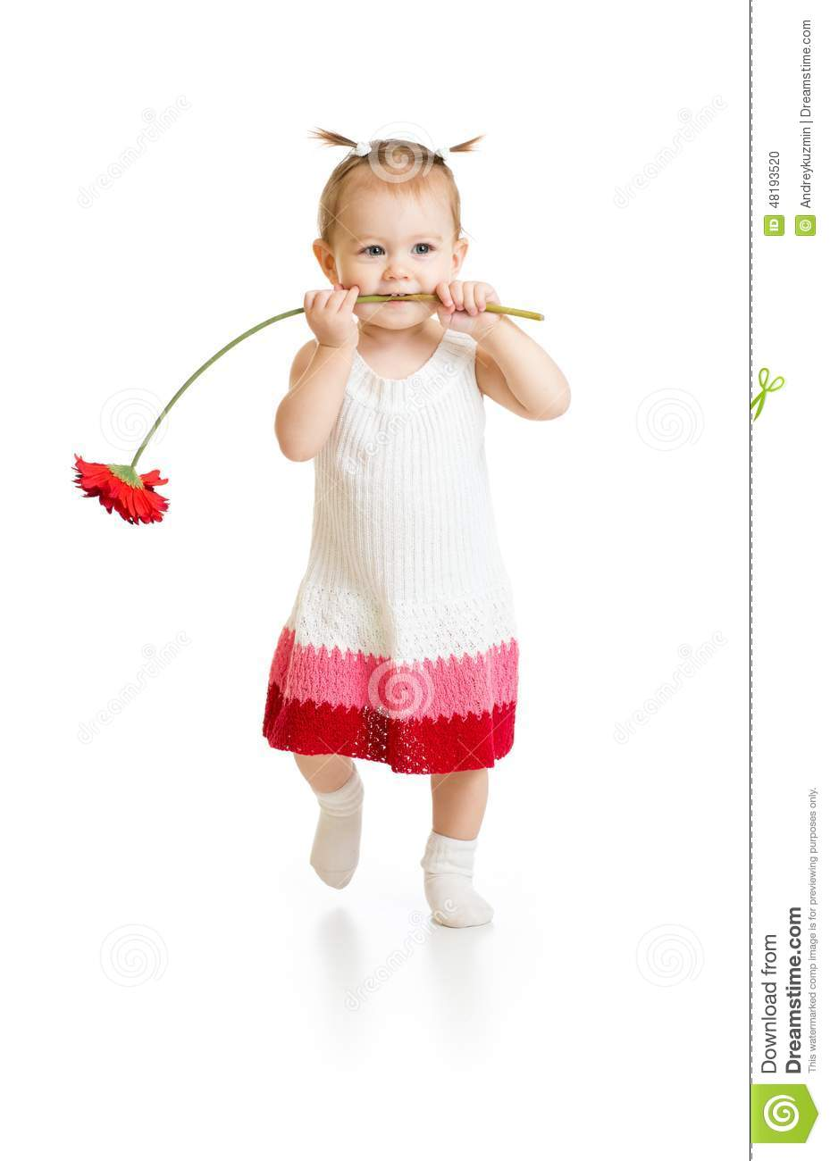 Adorable baby girl walking with flower in mouth