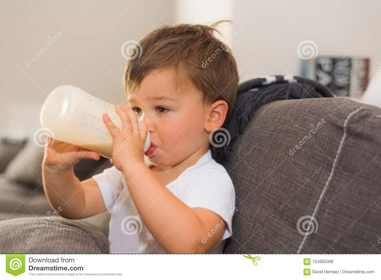 Adorable Baby Holding His Milk Bottle Stock Photo - Image ...