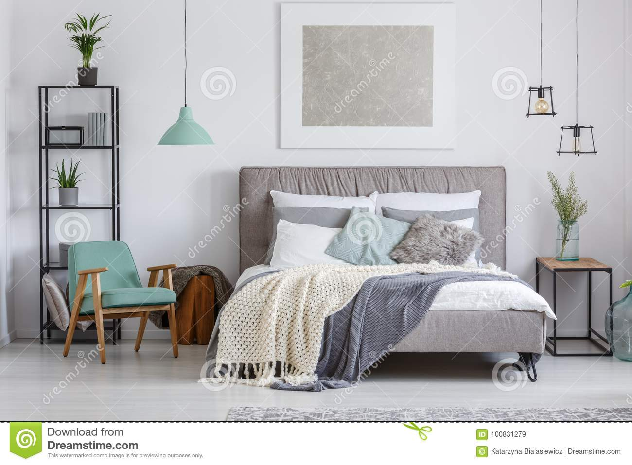 Adorable bedroom with mint chair