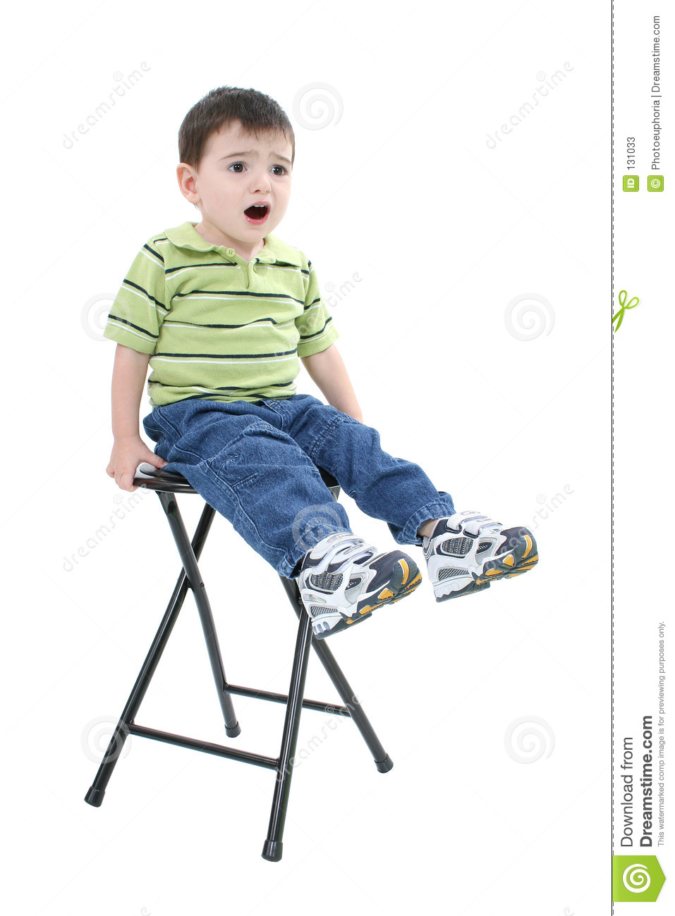 Adorable Boy Sitting On Stool With Upset Expression Stock Photos Image 131033