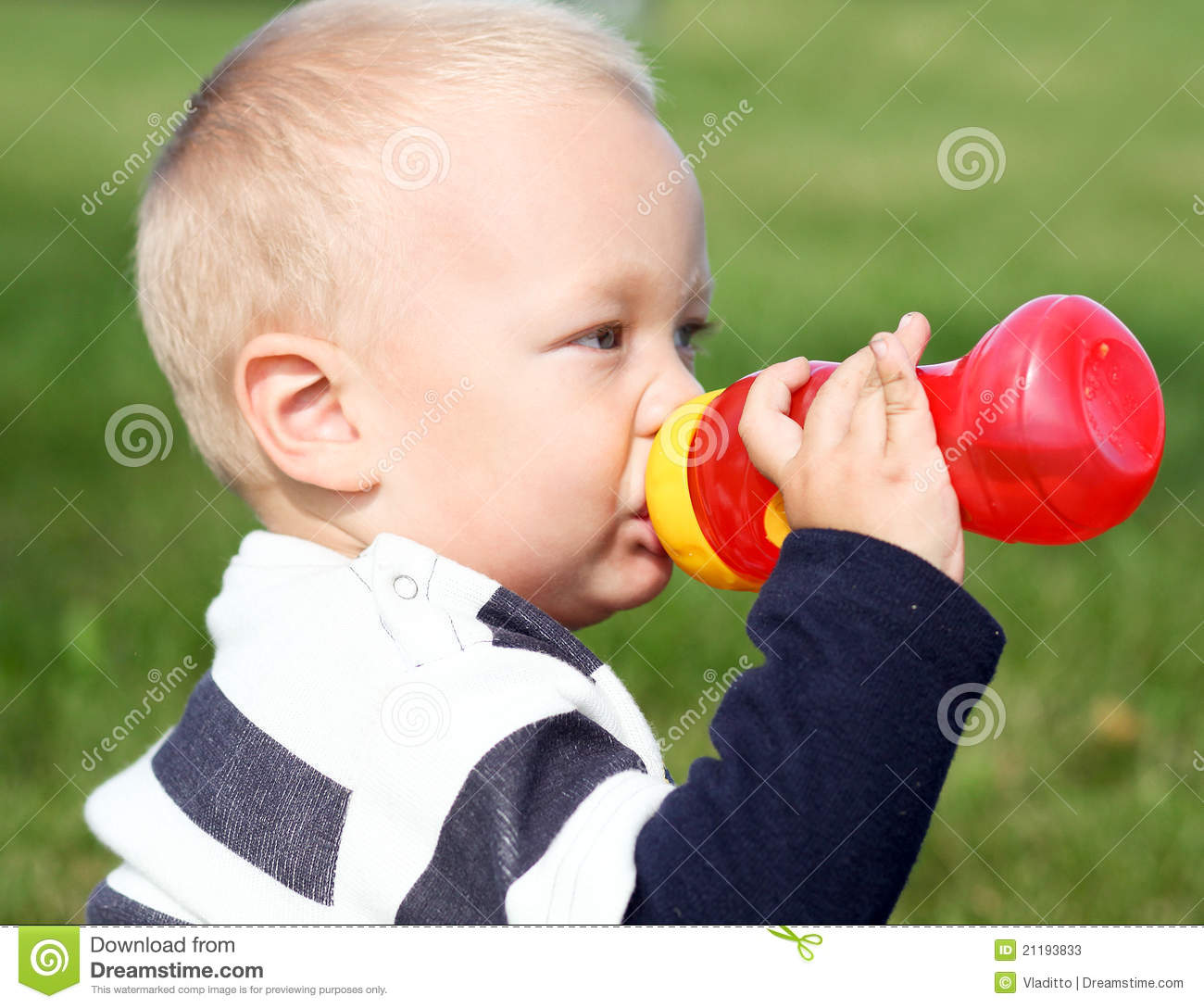 Adorable child drinking