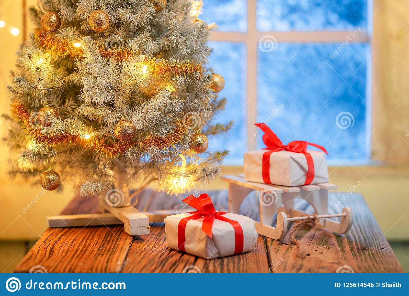 Adorable Christmas Tree And Gifts With Lights And Frozen Window ...
