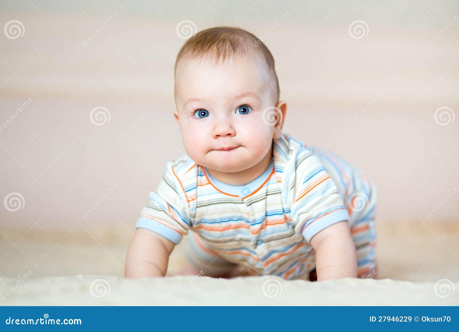 Adorable crawling baby boy indoors
