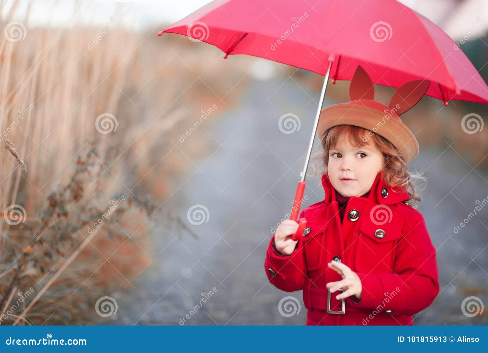 fdb400e8b Little Girl Walking With Umbrella