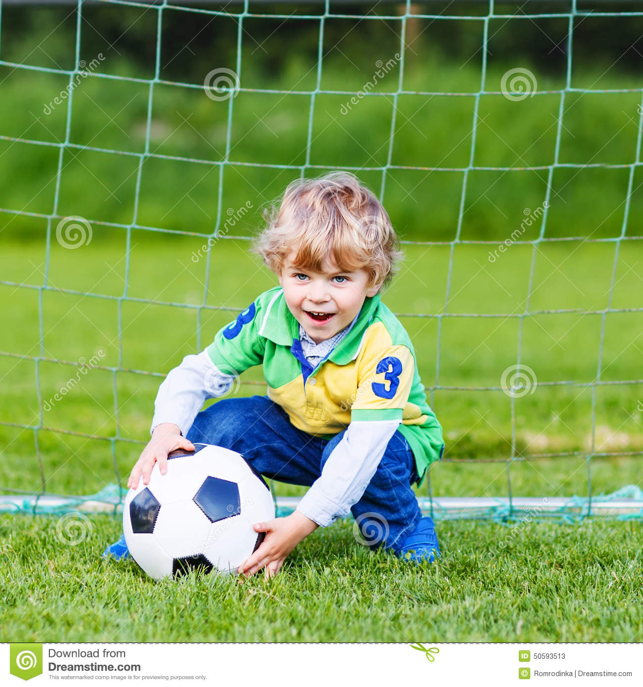 Young Children Playing Football Outdoors Stock Image ...