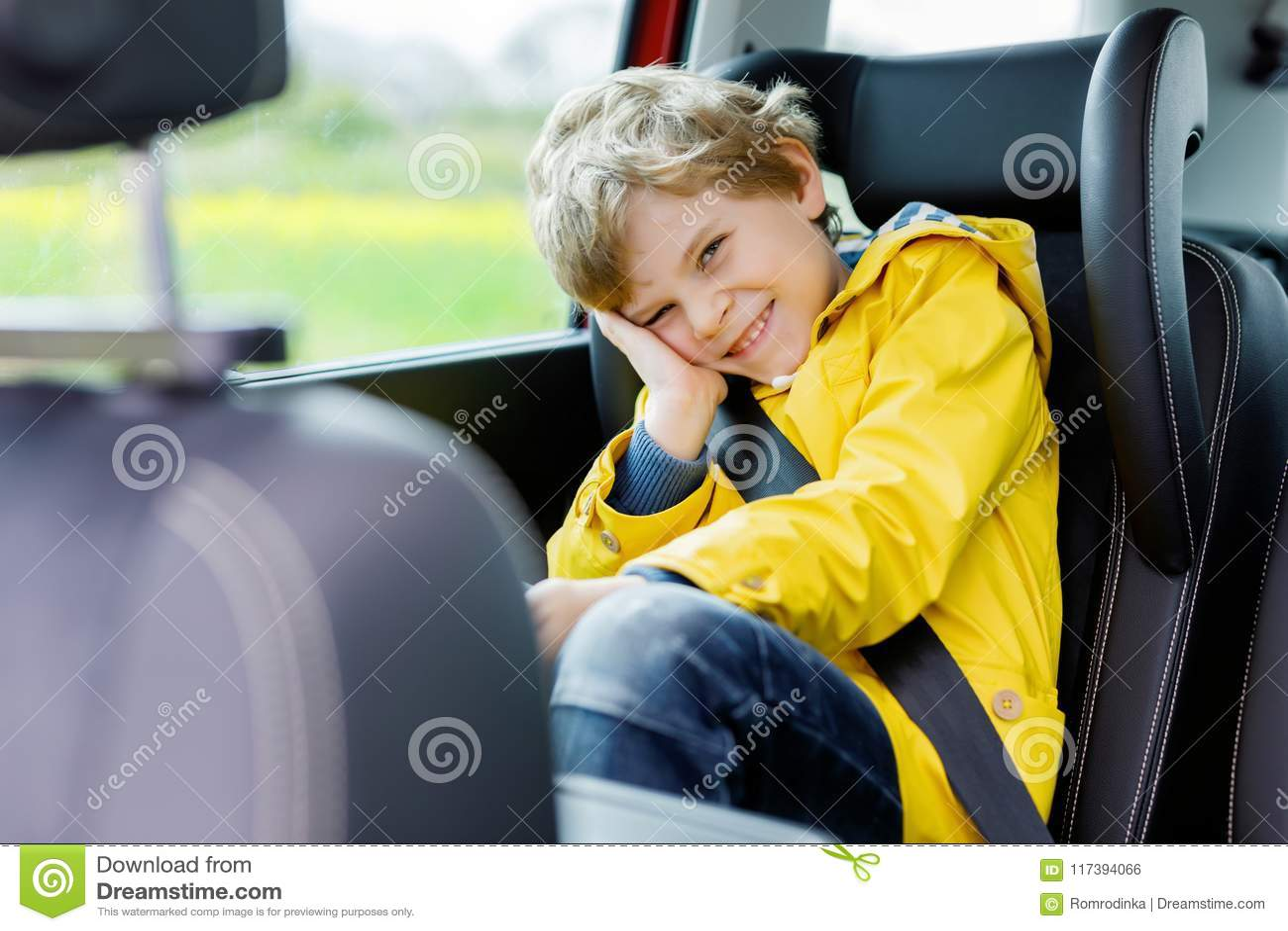 98ab639ca Adorable Cute Preschool Kid Boy Sitting In Car In Yellow Rain Coat ...
