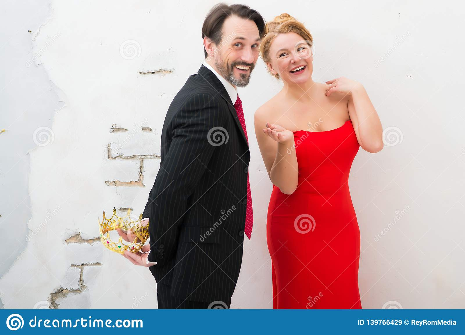Adorable elegant couple expressing cheer while having a date