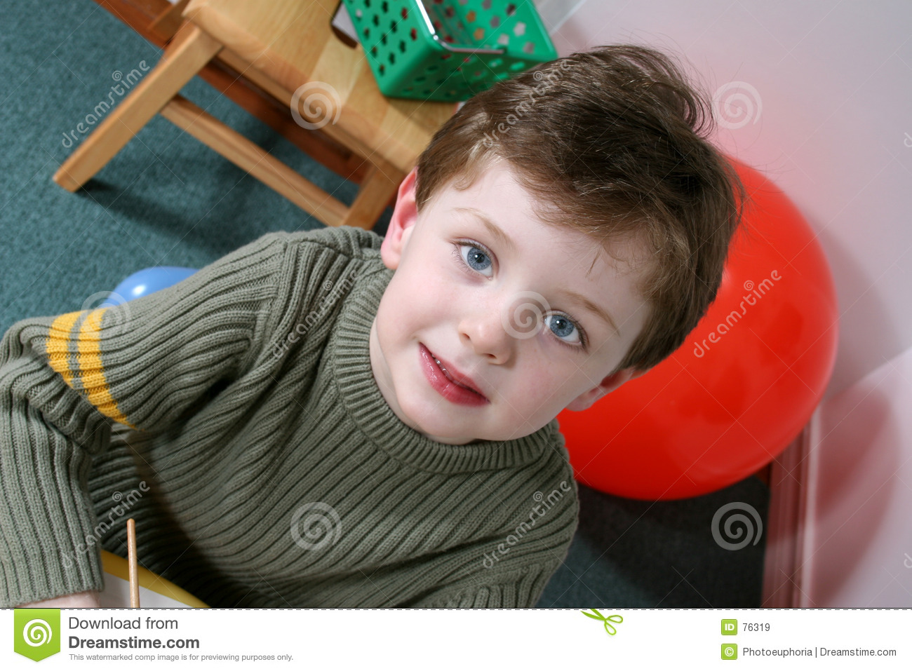 Adorable Four Year Old Boy with Blond Hair Blue Eyes