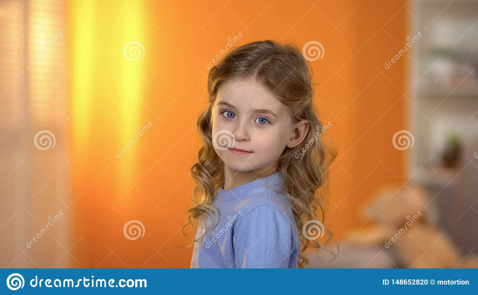 Adorable girl with beautiful hairstyle looking at camera, birthday celebration