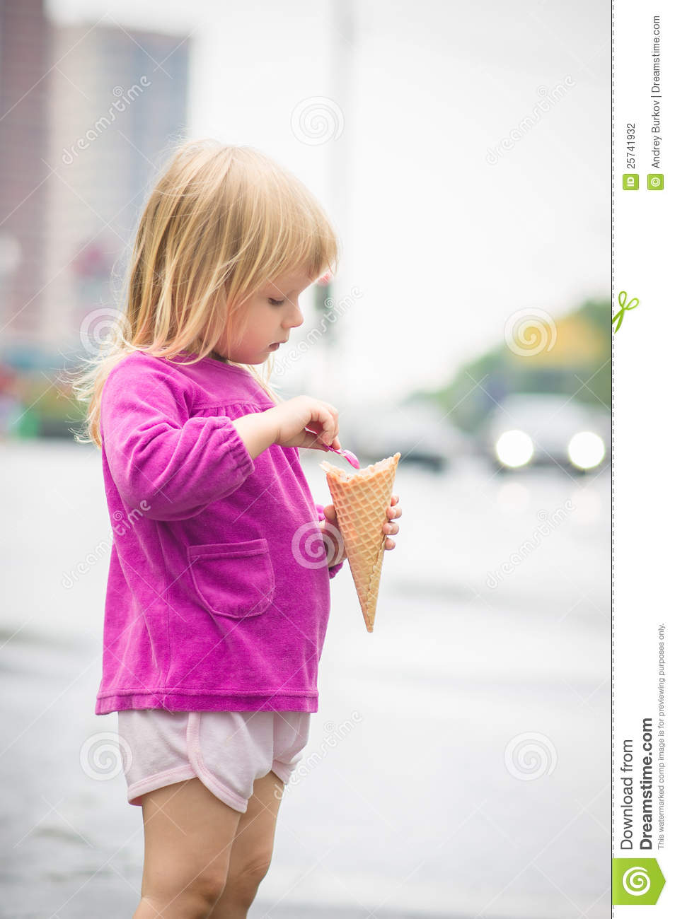 Adorable girl eat ice cream on bus stop