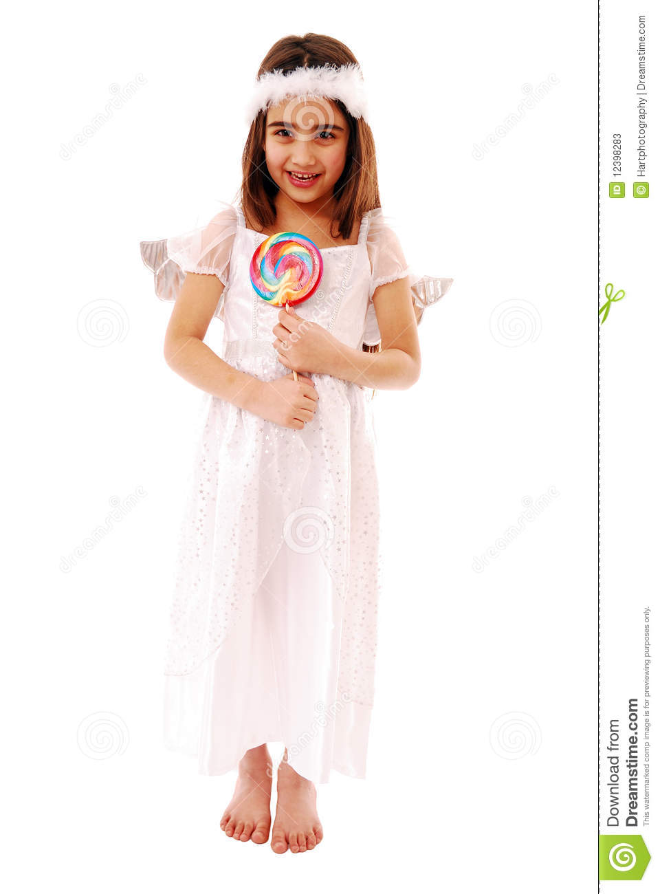 Adorable girl holding lolly pop