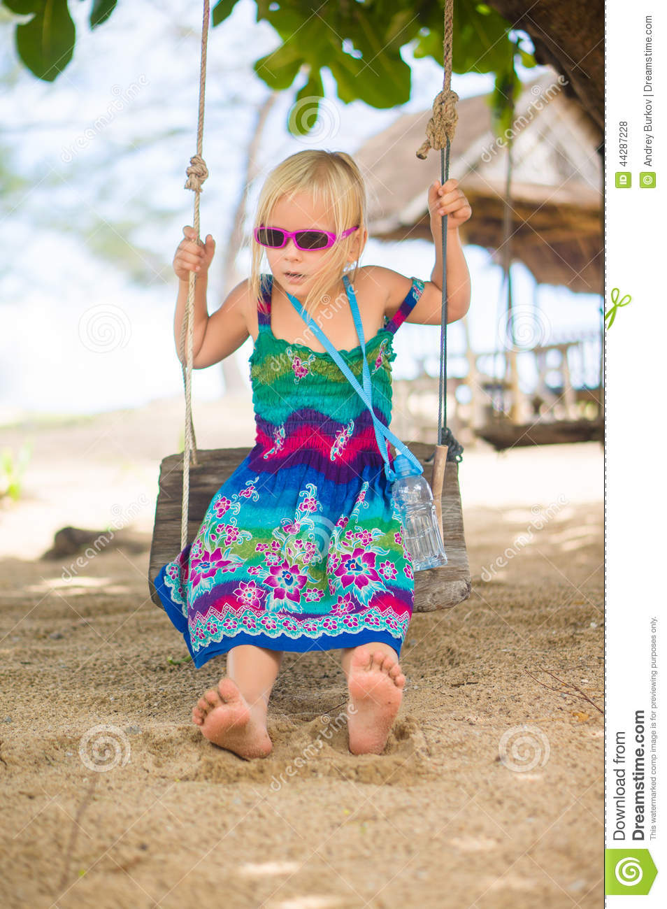 Adorable Girl In Sunglasses Sit On Rope Swing Under Palm ...
