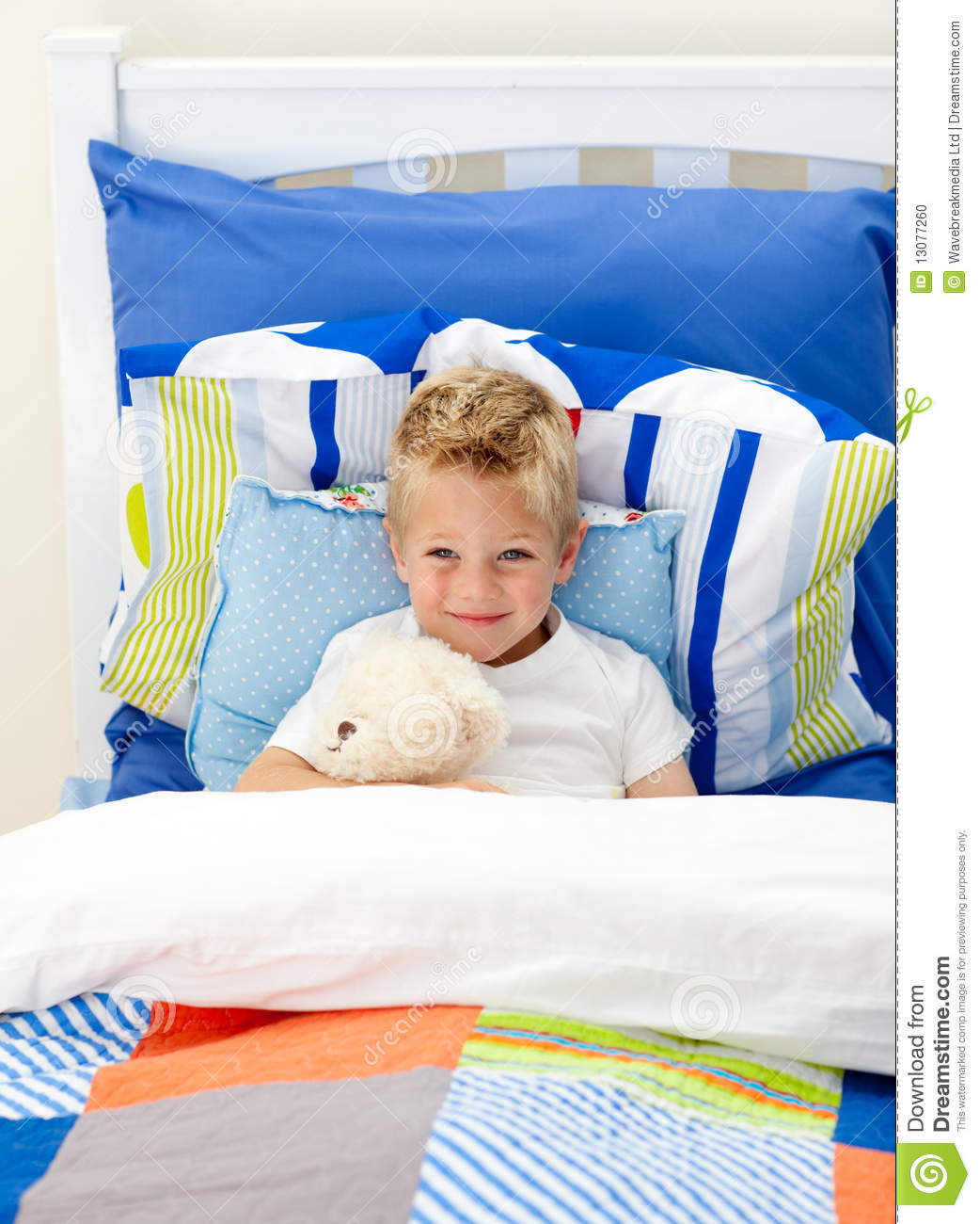 adorable little boy lying in bed stock photo image 13077260. Black Bedroom Furniture Sets. Home Design Ideas