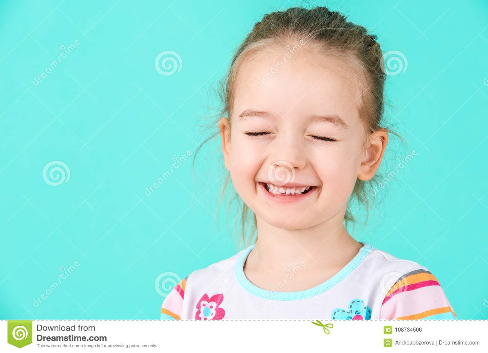 Adorable little girl with attitude. Cheeky preschooler headshot portrait.