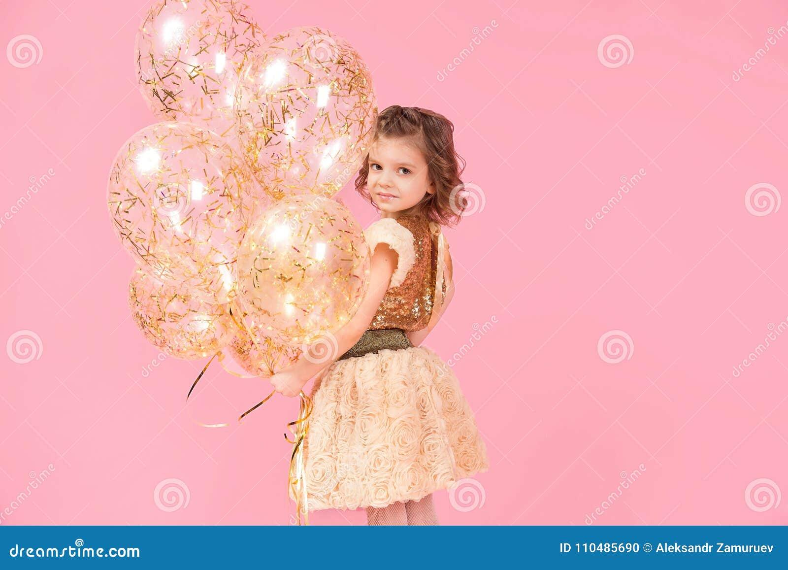 Adorable girl with balloons