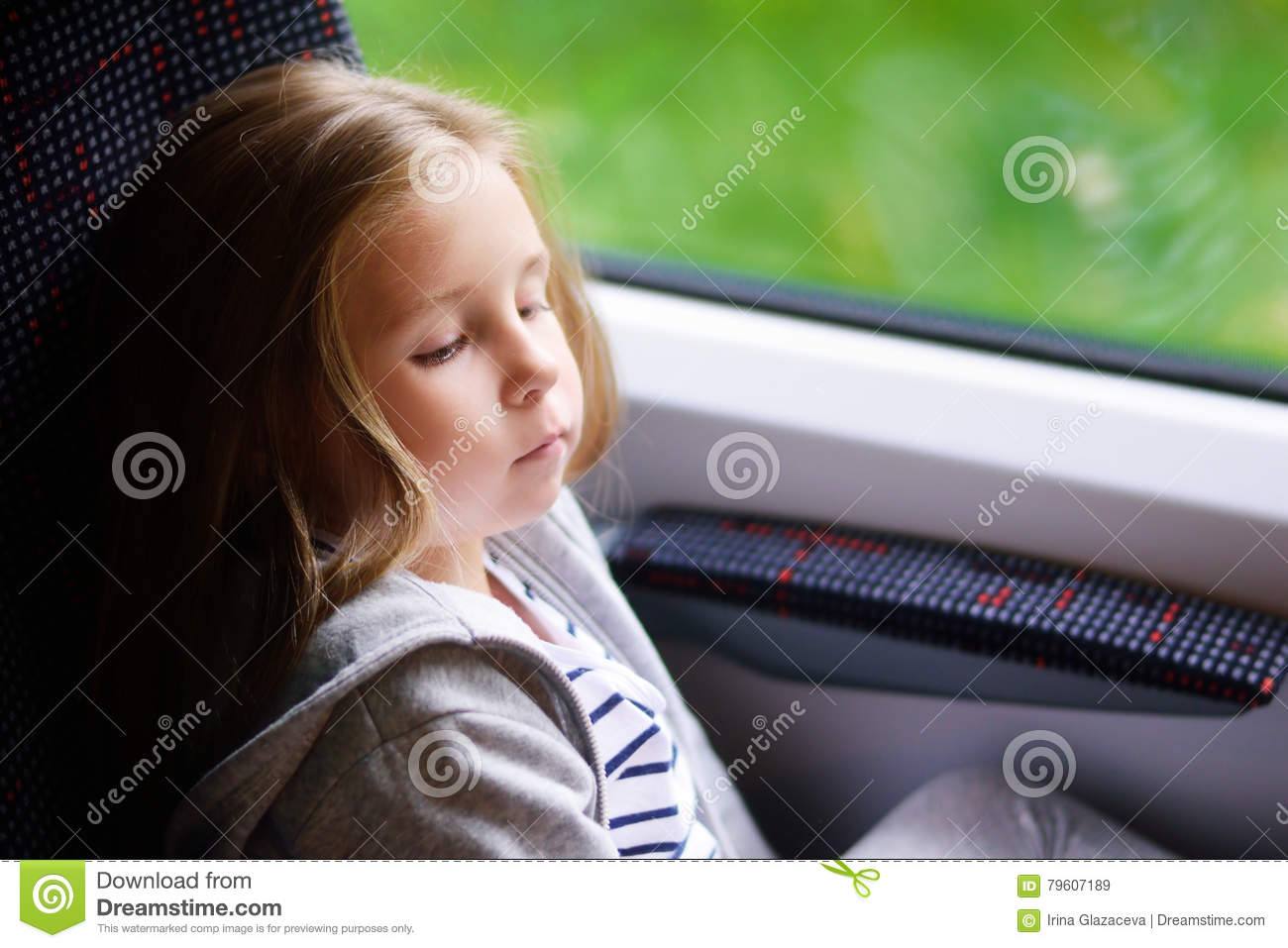 Adorable little girl going on vacations and traveling by railway.