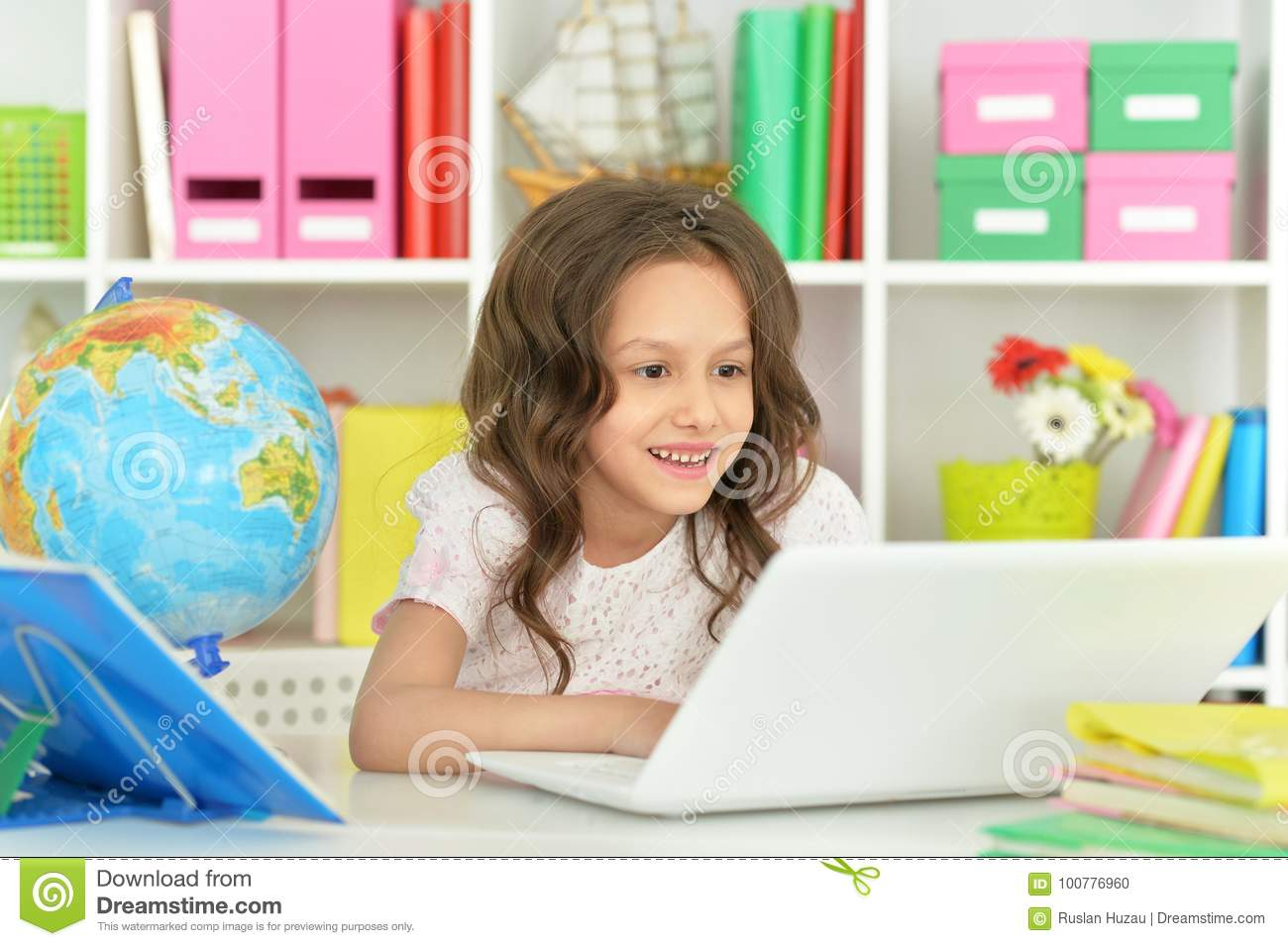 Adorable little girl with laptop