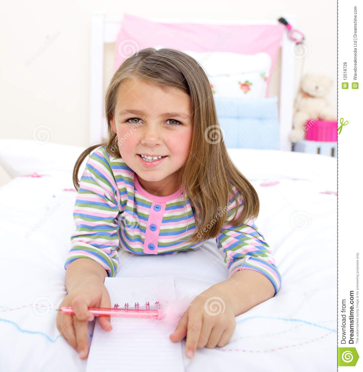 Adorable Little Girl Lying On Her Bed Royalty Free Stock