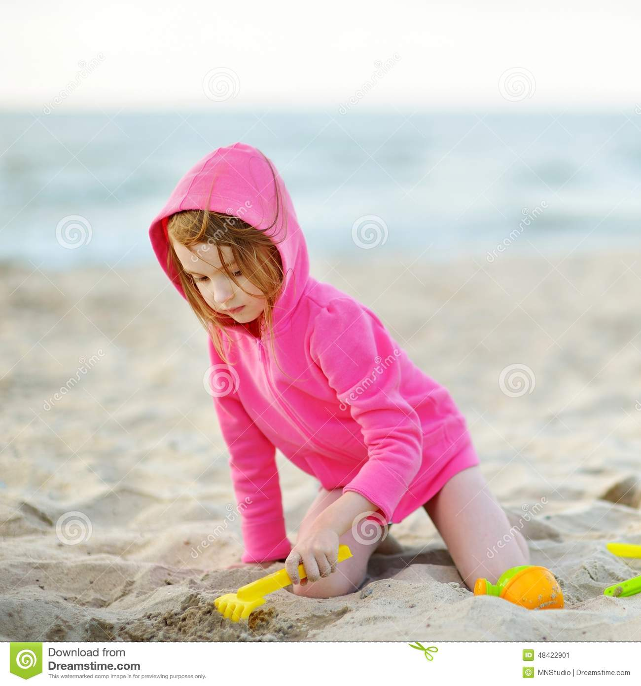 Adorable Little Girl Playing With Beach Toys During: Adorable Little Girl Playing On A Beach Stock Photo