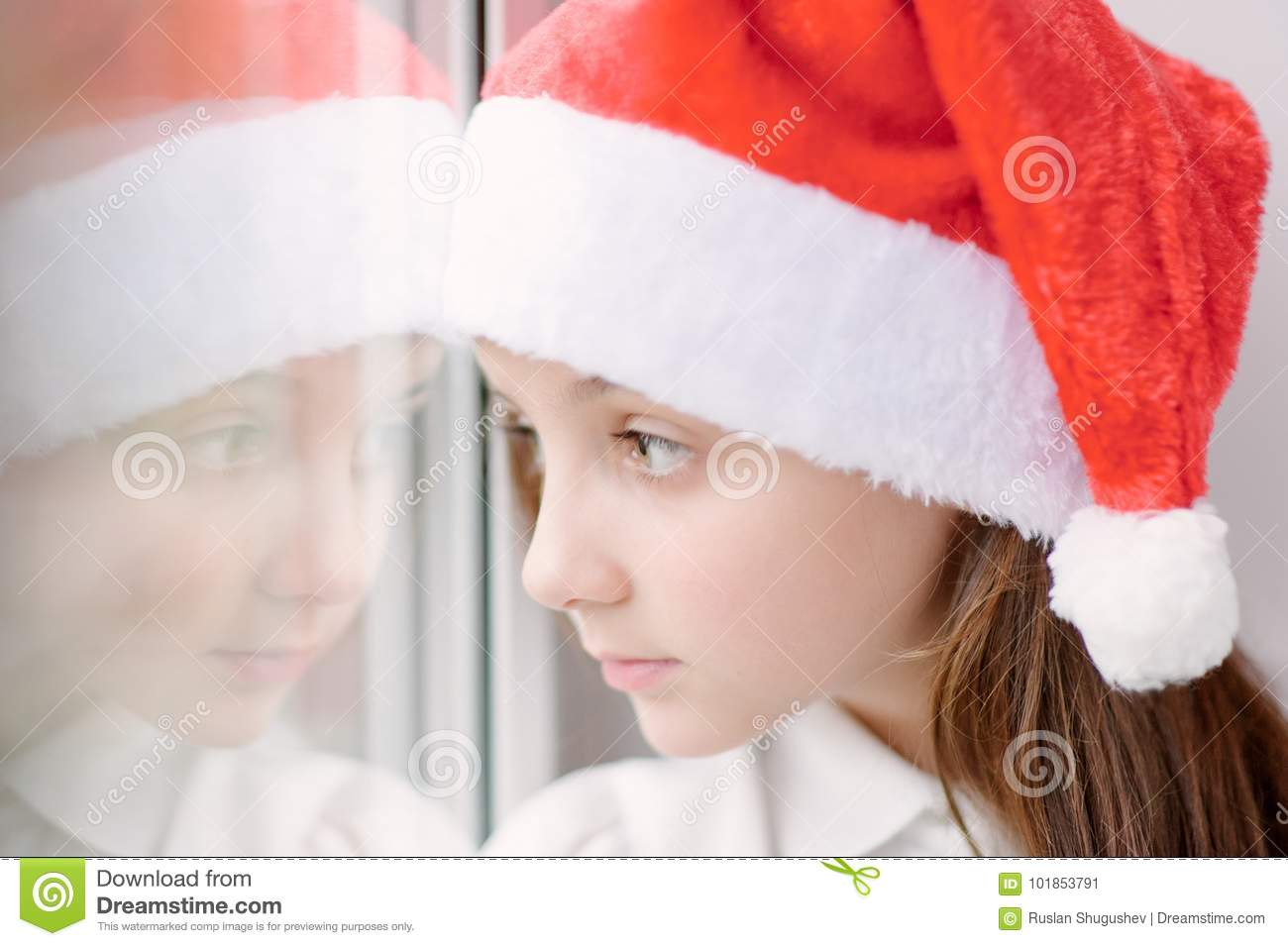 1aed1e363898c Adorable Little Girl In Santa Hat Near The Window Stock Image ...