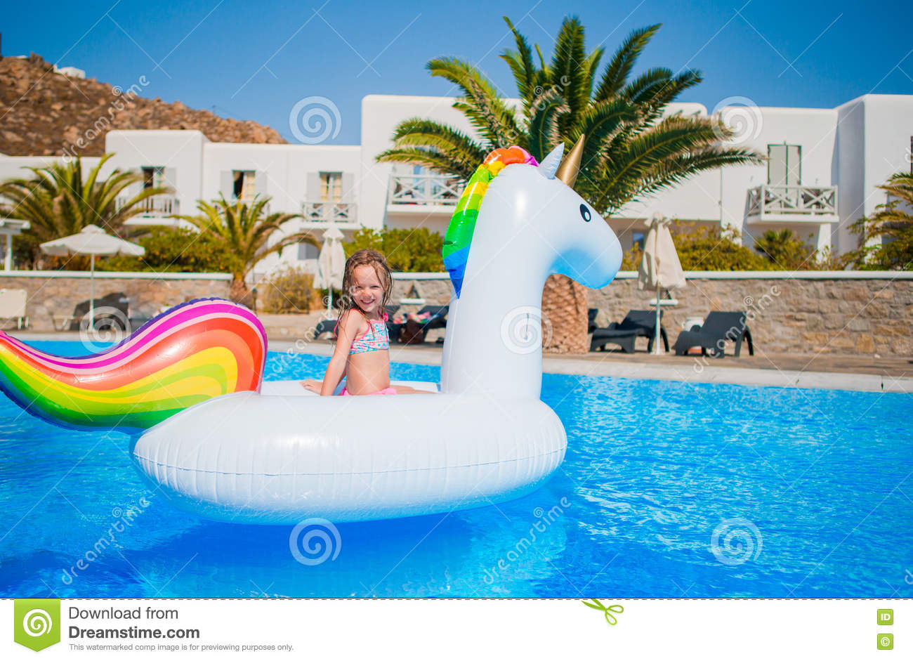 adorable little girl at swimming pool having fun during. Black Bedroom Furniture Sets. Home Design Ideas