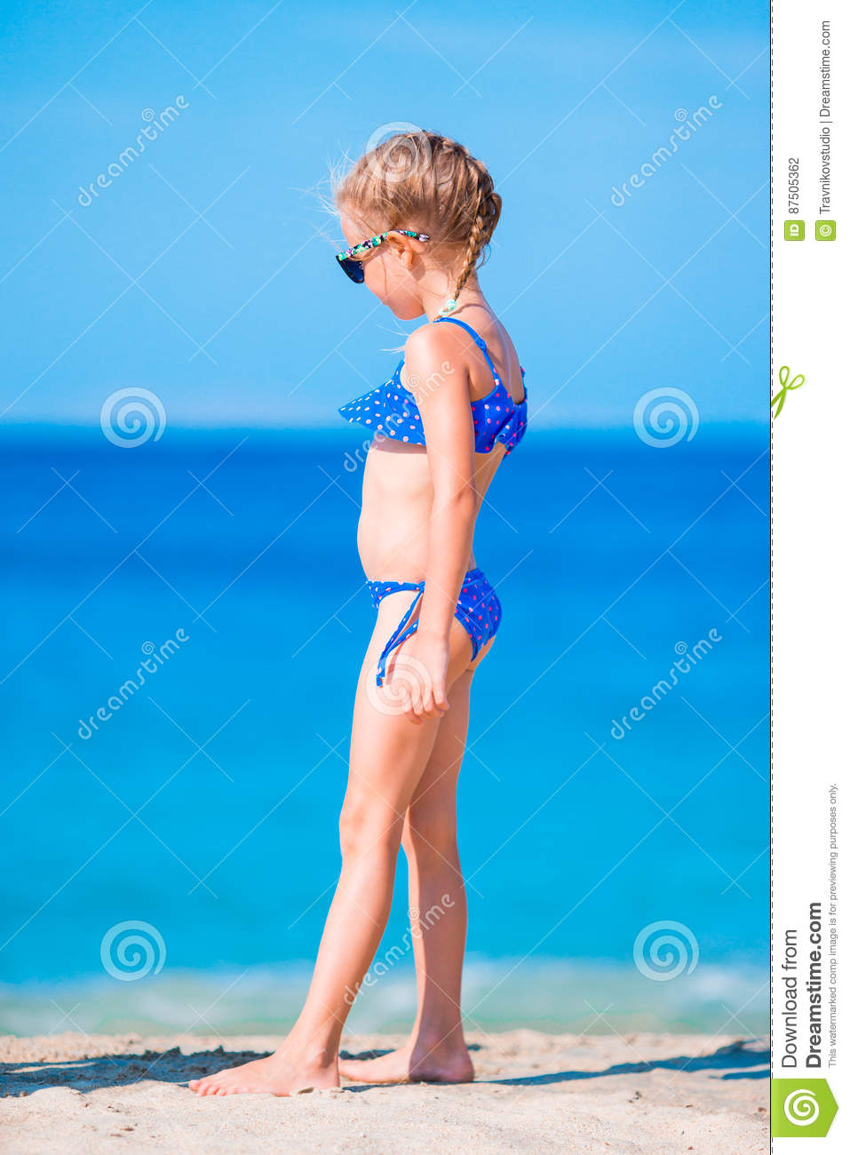 b91d6cf473bfc Adorable Little Girl In Swimsuit On Beach Vacation Stock Photo ...