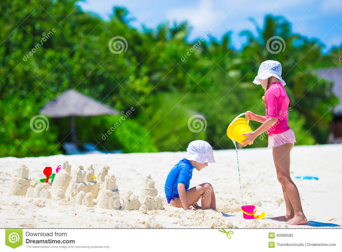 Beach Toys For Girls : Adorable little girls playing with beach toys stock photo