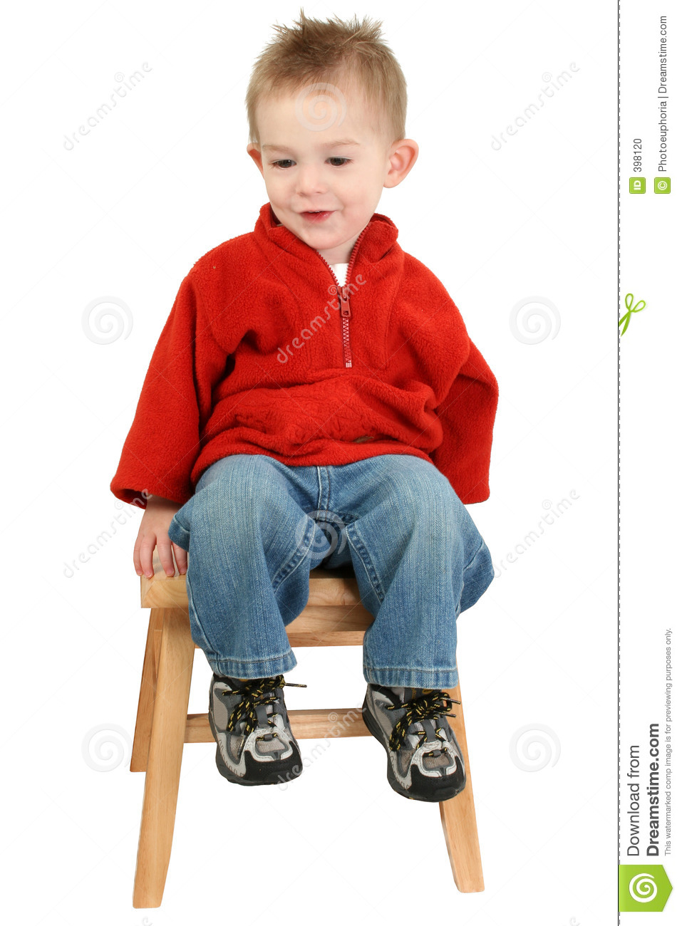 Adorable One Year Old Boy Sitting On Step Stool Stock