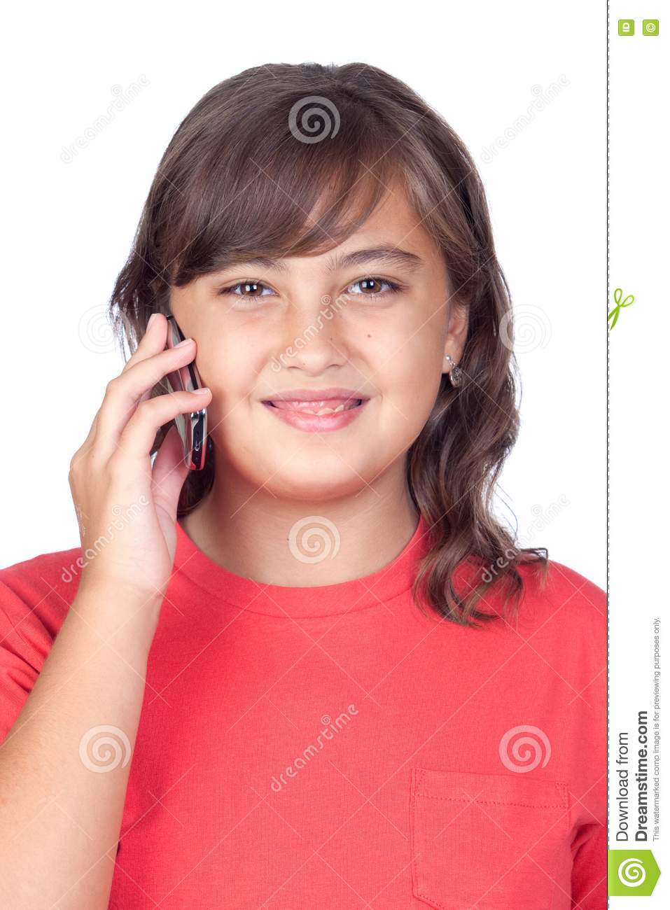 Adorable preteen girl with a mobile isolated on white background.