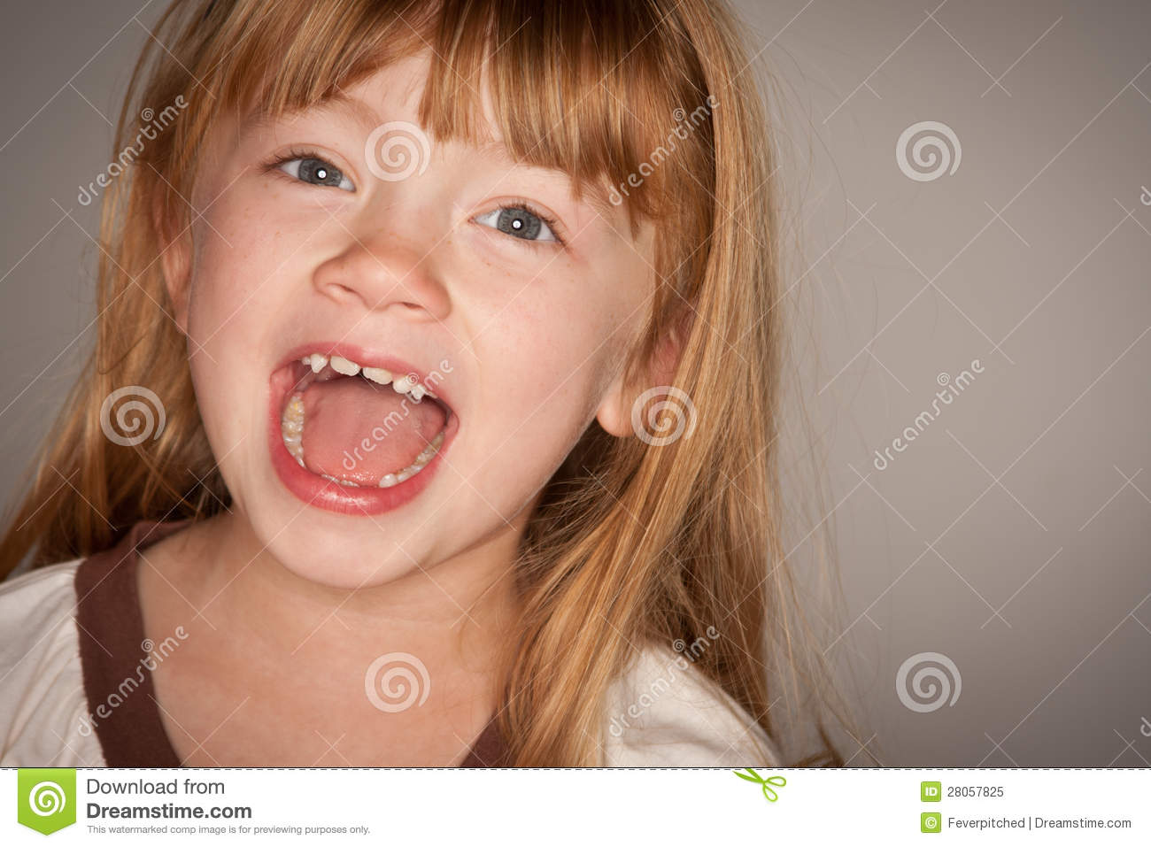 Adorable Red Haired Girl Laughing on Grey