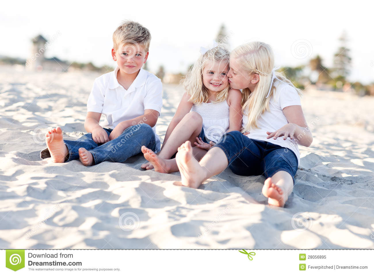 Adorable Sisters And Brother Having Fun At The Beach Stock
