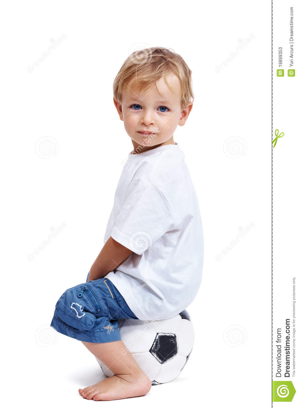 Adorable Small Kid Sitting On The Soccer Ball Stock Image