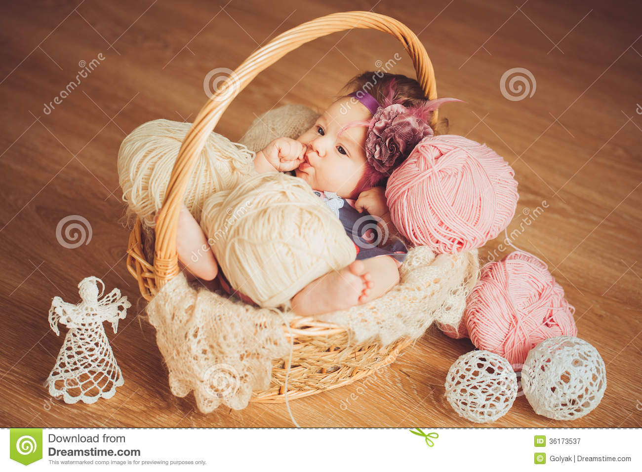 Adorable Smiling Newborn Baby Girl Lies In Basket Royalty